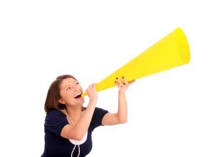 A picture of a young happy woman with a megaphone announcing your product over white background Stock Photo - 13325117