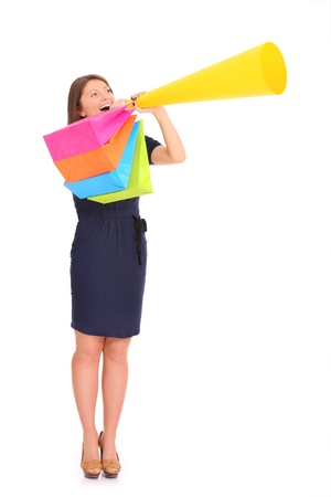 announcing: A picture of a young happy woman with a megaphone announcing your product over white background