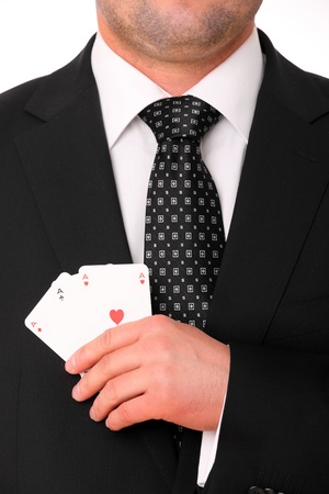 A picture of a young businessman hand holding three aces  photo