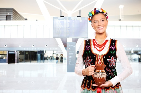 A portrait of a beautiful and hospitable Polish woman in a traditional outfit at the airport Stock Photo - 13325194