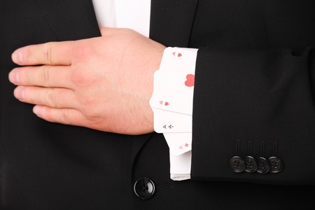 trickster: A picture of a young businessman hand holding three aces