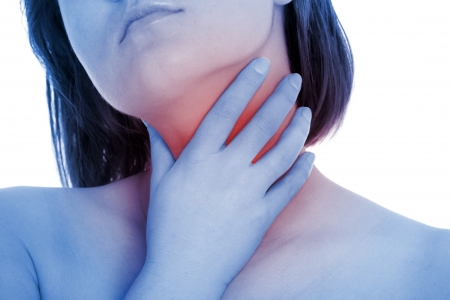 neck: A picture of a young woman suffering from tonsillities over white background