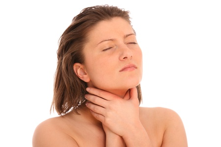 A picture of a young woman suffering from sore throat over white background photo