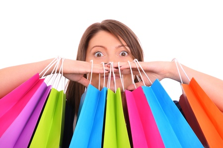 among: A picture of a young happy woman among shopping bags over white background
