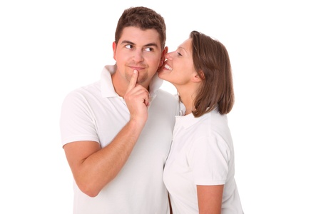 A picture of a young woman whispering to her boyfriend over white background photo