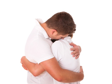 forgiveness: A picture of a young couple hugging over white background Stock Photo