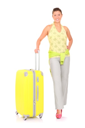 A picture of a young woman with a big suitcase standing over white background Stock Photo - 13753666