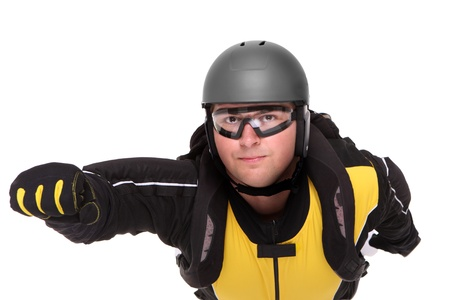 A picture of a young parachutist flying over white background photo