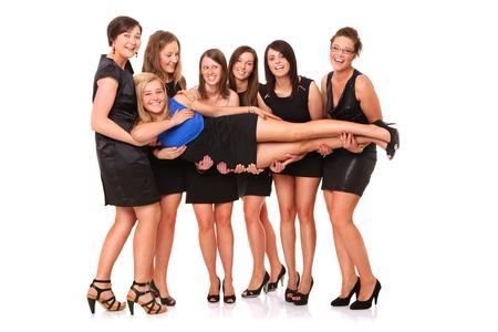 despedida de soltera: Un retrato de siete amigas que celebran la despedida de soltera m�s de fondo blanco Foto de archivo