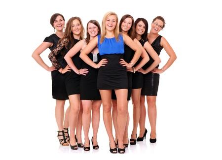 A portrait of seven girlfriends celebrating bachelorette party over white background photo