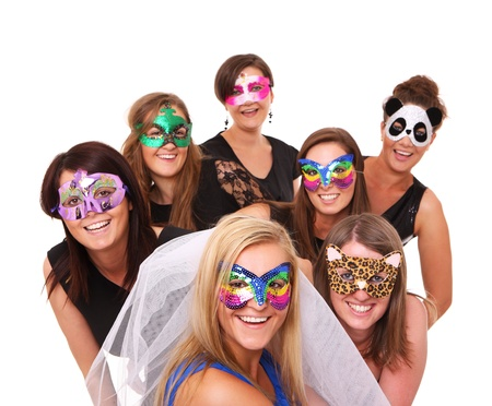 A portrait of seven girlfriends in party moods smiling over white background Stock Photo