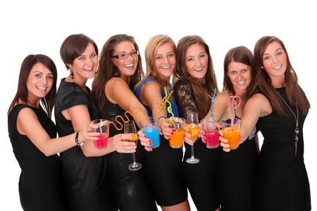 A portrait of seven girlfriends in party moods smiling and drinking over white background photo