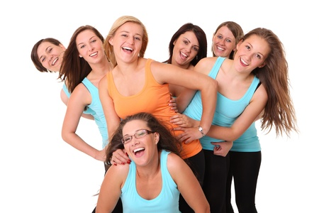 bachelorette party: A portrait of seven sporty girlfriends having fun over white background Stock Photo