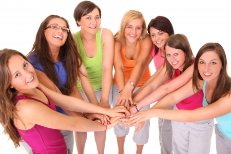 girl bonding: A picture of young women standing in a circle and bonding their hands