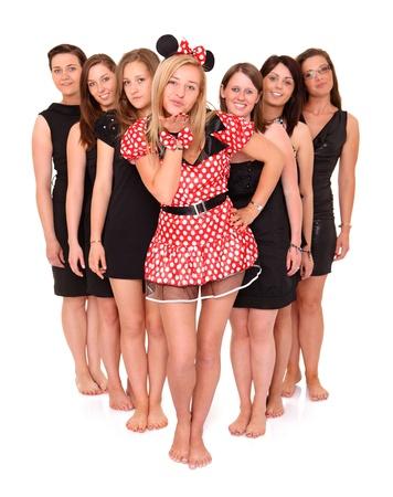 A portrait of seven girlfriends celebrating bachelorette party over white background photo