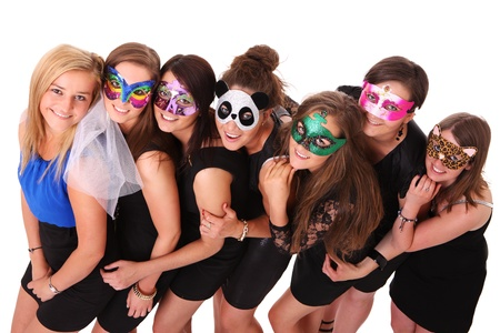 A portrait of seven girlfriends in carnival masks smiling over white background Stock Photo - 13910699
