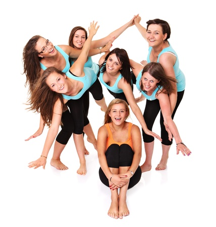 A portrait of seven sporty girlfriends having fun over white background photo
