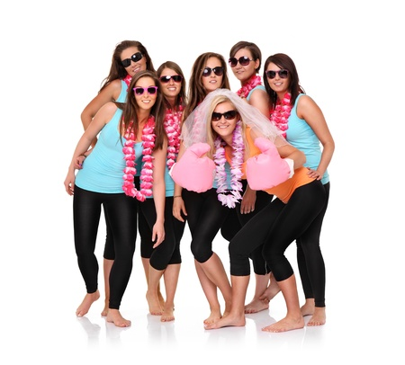 people partying: A portrait of seven sporty girlfriends having fun over white background Stock Photo