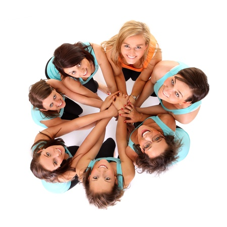 woman in white: A picture of young women standing in a circle and bonding their hands