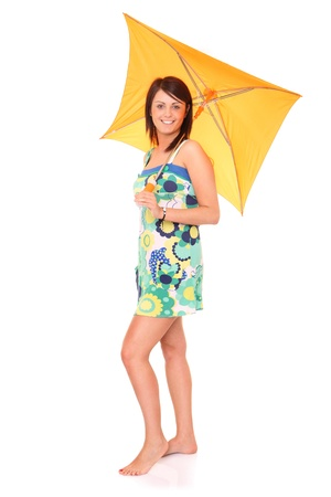 A picture of a young positive woman standing under umbrella and smiling over white background Stock Photo - 14164498