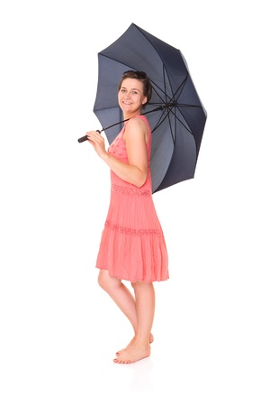 A picture of a young positive woman standing under umbrella and smiling over white background Stock Photo - 14164496