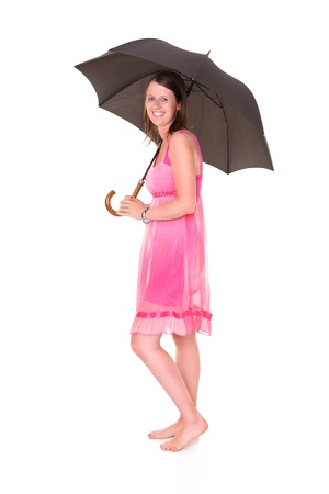 A picture of a young positive woman standing under umbrella and smiling over white background Stock Photo - 14164491