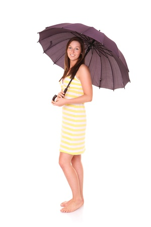 A picture of a young positive woman standing under umbrella and smiling over white background Stock Photo - 14164494
