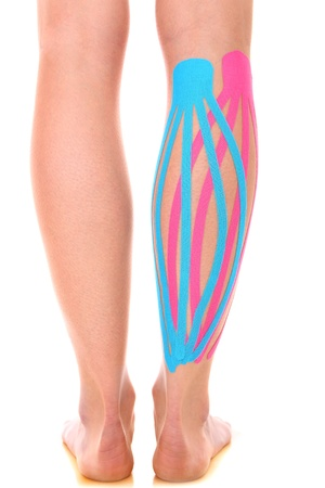 calves: A picture of a special physio tape put on an injured calf over white background