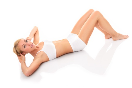 situps: A picture of a beautiful young woman doing sit-ups over white background