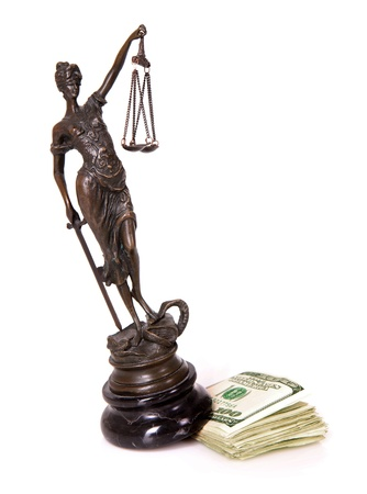 A picture of a Themis statue being displaced by dollar notes over white background photo