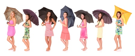 A picture of seven young positive women standing under umbrella and smiling over white background Stock Photo - 14394393