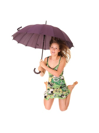 A picture of a young positive woman jumping with an umbrella and smiling over white background Stock Photo - 14394445