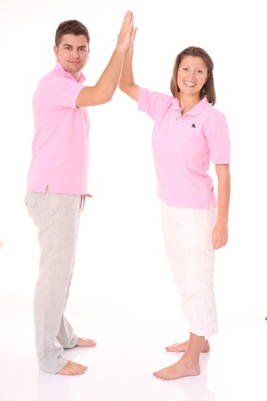A picture of a young happy couple giving five over white background photo
