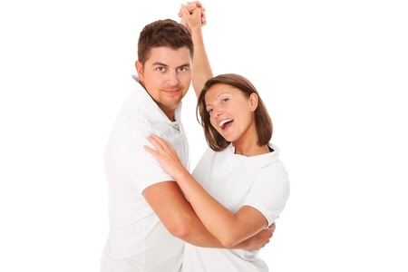 A picture of a young couple dancing over white background