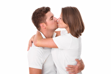 A picture of a cute young couple kissing over white background Stock Photo - 14466253