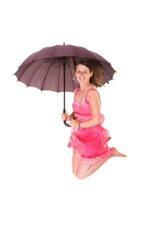 A picture of a young positive woman jumping with an umbrella and smiling over white background Stock Photo - 14549105