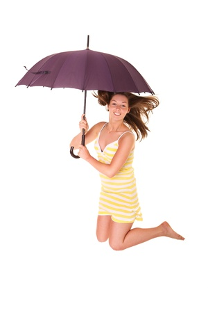 A picture of a young positive woman jumping with an umbrella and smiling over white background Stock Photo - 14549104