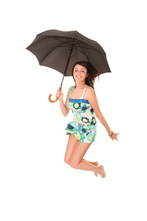 A picture of a young positive woman jumping with an umbrella and smiling over white background Stock Photo - 14549101