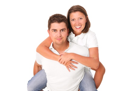 A picture of a young happy man giving a piggyback to his woman over white background Stock Photo - 14549112