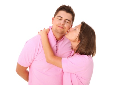 A picture of a young woman kissing her man over white background Stock Photo - 14549108