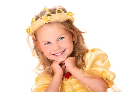 yellow dress: A portrait of an adorable little girl smiling over white background Stock Photo