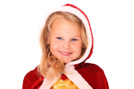 A portrait of a sweet little girl in Santa's cape smiling over white background Stock Photo - 15030066