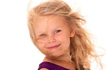 A portrait of a beautiful little girl smiling over white background photo
