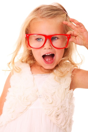 A portrait of a young girl model posing with red glasses over white background photo
