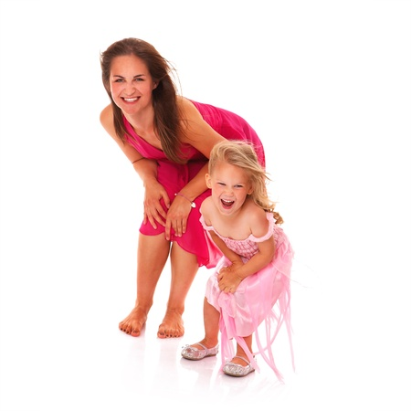 little girl dancing: A portrait of a mother and daughter dancing and smiling over white background