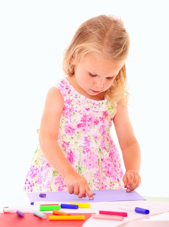 clay modeling: A portrait of a beautiful little girl playing with plasticine over white background