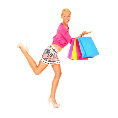 A picture of a young sexy woman with shopping bags over white background Stock Photo - 16056489
