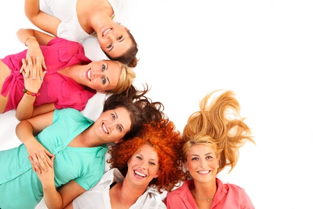 A picture of five beautiful girls lying on the floor and smiling over white background Stock Photo - 16057140