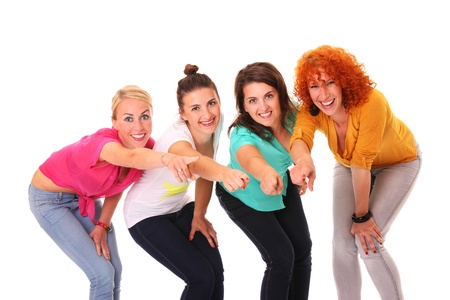 A picture of four women smiling and pointing at something over white background Stock Photo - 16056511