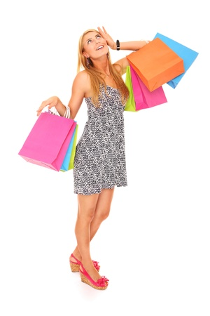 A picture of a young happy woman with shopping bags standing over white background Stock Photo - 16056505